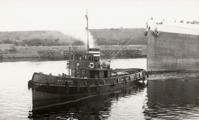 MSC NYMPH towing in the Canal